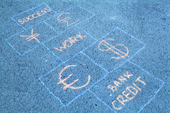 Business is a game. Business hopscotch made on sidewalk Stock Photos