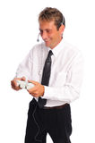 Business gamer. Business man taking a break to play video games set on a white background Stock Photo