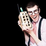 Business Geek Laughing On House Brick Phone Royalty Free Stock Photos