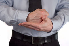 Business gesture. The picture shows a man making a gesture royalty free stock photography