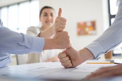 Group of business team making thumbs up gesture royalty free stock photography