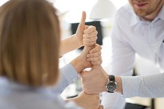 Group of business team making thumbs up gesture stock images
