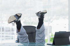 Business getting crazy falling from his swivel chair. In bright office Stock Images
