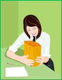 Business gift. Smiling girle receiving a gift Royalty Free Stock Images