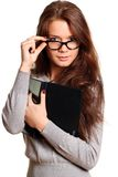 Business girl. Portrait of the young woman with the daily log in hands Royalty Free Stock Image