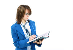Secretary making notes in book. Young attractive secretary making notes in notebook on white background Royalty Free Stock Images