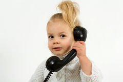 Business girl. A little cute girl makes a telephone call Stock Photography