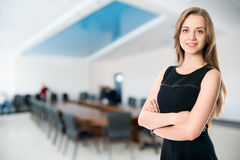 Business girl on the background of the hall for business meeting Stock Photo