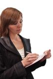 A business girl does a record in a notebook Royalty Free Stock Photos