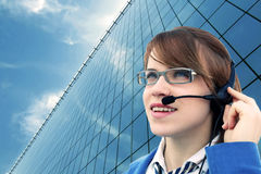 Business girl with glass office and headset Royalty Free Stock Photos