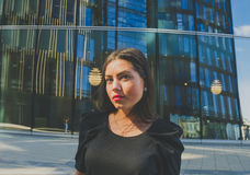 Free Business Girl In Black Closeup On Background Of Modern Building Royalty Free Stock Image - 76226446