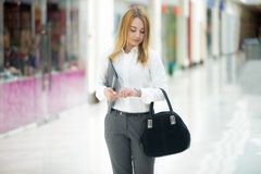 Business girl looking at watch Stock Image