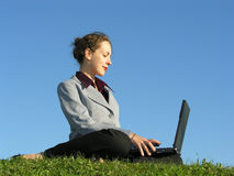 Business girl with notebook. On blue sky stock photography