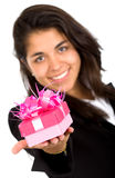 Business girl offering a gift Royalty Free Stock Photo