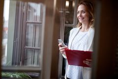 Business girl in office with mobile phone Stock Photos