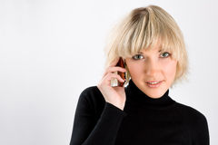 Business girl on the phone. Over a gray background royalty free stock photography
