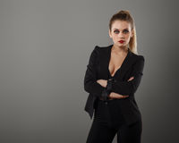 Business girl posing in the studio. On a gray background royalty free stock photos