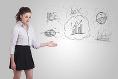 Business girl presenting hand drawn sketch graphs and charts Royalty Free Stock Photos