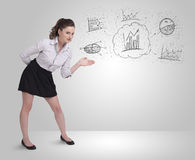 Business girl presenting hand drawn sketch graphs and charts Royalty Free Stock Photography