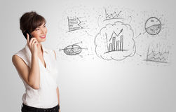 Business girl presenting hand drawn sketch graphs and charts. Concept Stock Photos