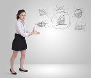 Business girl presenting hand drawn sketch graphs and charts Stock Photos