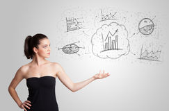 Business girl presenting hand drawn sketch graphs and charts. Concept Stock Image