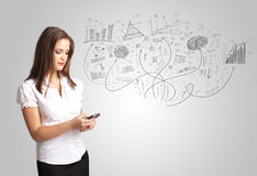 Business girl presenting hand drawn sketch graphs and charts. Concept Stock Photography