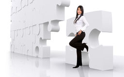 Business girl with puzzle Royalty Free Stock Images