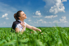 Business girl relaxing on field Stock Photography
