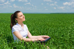 Business girl relaxing on field Stock Photo