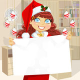 Business girl in Santa cap hold blank banner Royalty Free Stock Images