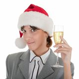 Business girl in Santa hat and with champagne Stock Image
