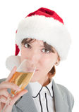 Business girl in Santa hat and with champagne Royalty Free Stock Photography