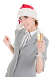 Business girl in Santa hat and with champagne Royalty Free Stock Image