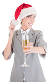 Business girl in Santa hat and with champagne. Portrait of business girl in Santa hat and with champagne Royalty Free Stock Image