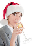 Business girl in Santa hat and with champagne. Portrait of business girl in Santa hat and with champagne Stock Image