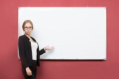 Business girl shows forefinger hand on the blank Royalty Free Stock Photo