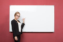 Business girl shows forefinger hand on the blank Royalty Free Stock Photography