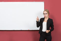 Business girl shows forefinger hand on the blank Stock Images