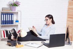 Business girl sits at a computer in the Office paper folders Royalty Free Stock Photos