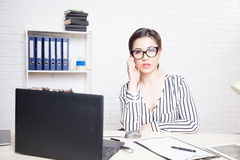 Business girl sits at a computer in the Office paper folders Royalty Free Stock Images