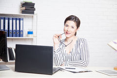 Business girl sits at a computer in the Office paper folders Stock Photos