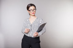 Business girl sits in the Office paper folders portrait Stock Images