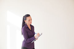 Business girl stands with folder with the documents Royalty Free Stock Photos