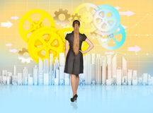 Business girl stands turned back and looks at Stock Image