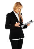 Business girl taking notes Royalty Free Stock Photos