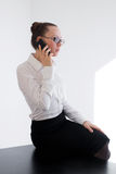Business girl talking on the phone Royalty Free Stock Photography