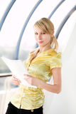 Business girl in yellow with paper Royalty Free Stock Photography