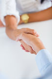 Business girls greeting by handshaking. Royalty Free Stock Image