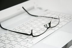 Business Glasses on the keyboard Royalty Free Stock Photography